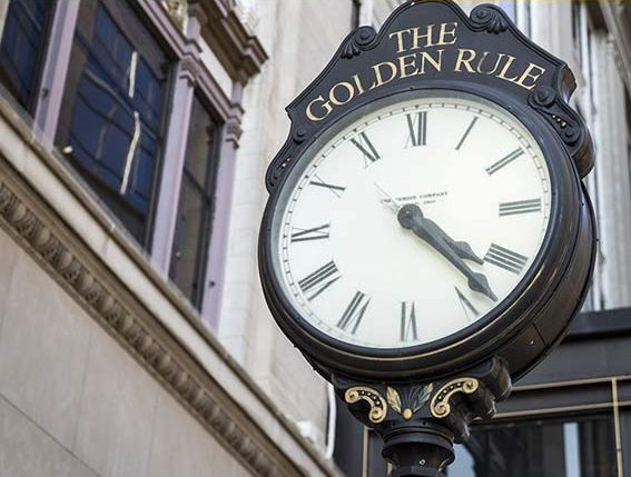 clock outside of The Golden Rule Building